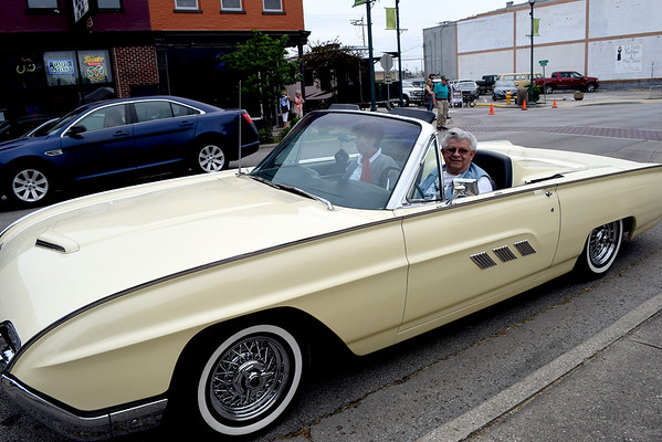 Art and Judy Trost of Altamont enjoy their Hi-Boy sandwiches in their 1963 Ford T-Bird Roadster during Cruise Night Friday evening.