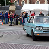 A Rambler passes by as spectators look on at Cruise Night Friday. Kaitlin Cordes photo