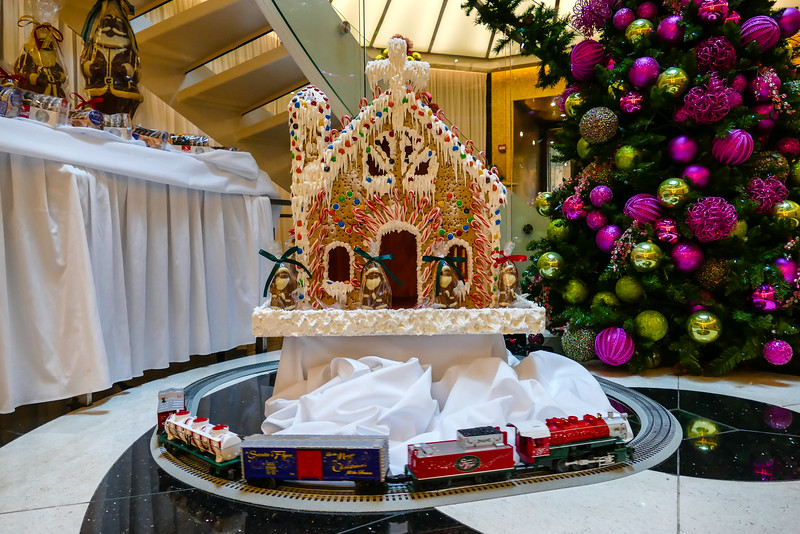 Toy train around a gingerbread house