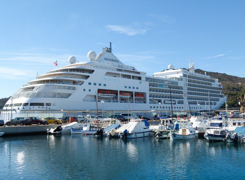 A white cruise ship docks in the small Spanish port of Cartagena.