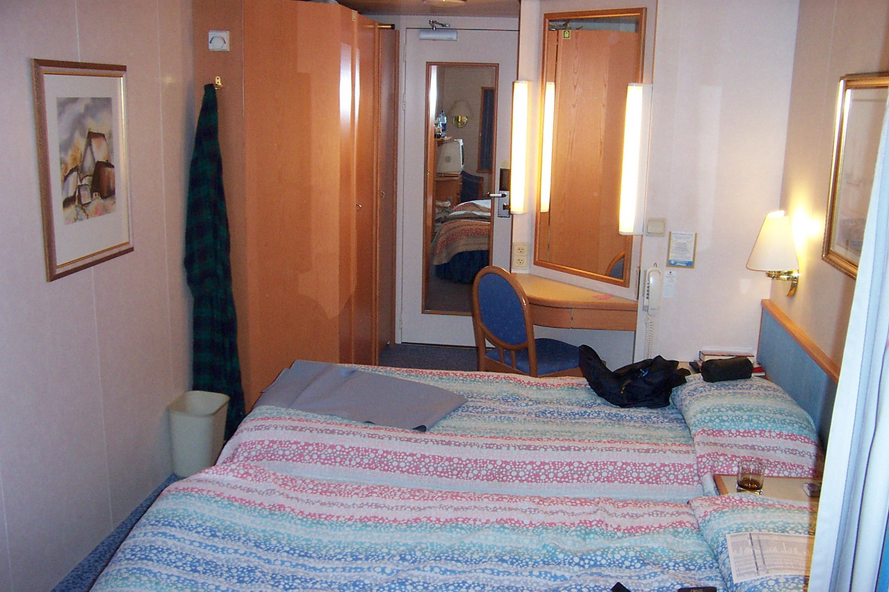 Looking back toward the cabin's door (at center with the mirror), the closet was to the left and the bathroom was just beyond the vanity on the right.<br /> [Aboard the Norwegian Dream cruise ship]
