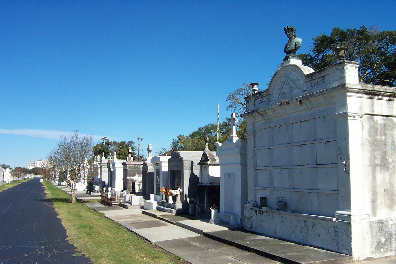 """Due to swampy land and a high water table, it's not practical to bury anything here.  So these interesting """"cities of the dead"""" were created.<br /> [New Orleans cemetery]"""