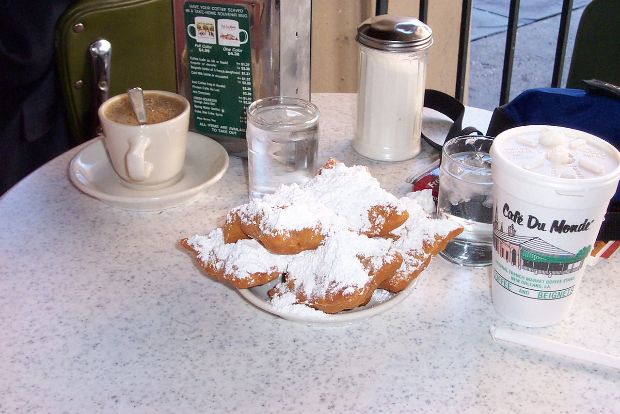 I think it's a law--you must have beignets and cafe au lait with chicory at Cafe du Monde.  Yum!!<br /> [New Orleans]