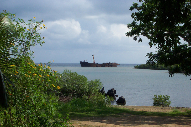 As we were driven around the island in a van, we passed a couple of modern-day shipwrecks near the shore, like the one seen here.  I can't remember the exact ages, but they both happened within the past 50 years.<br /> [Roatan, Honduras]
