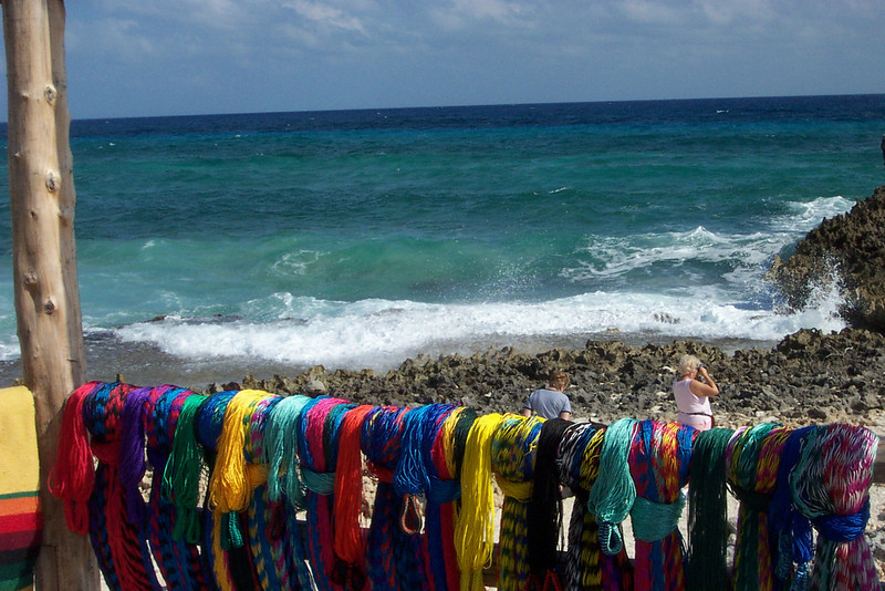 These colorful fishing nets were displayed outside a small giftshop on the east side of the island.<br /> [Cozumel, Mexico]