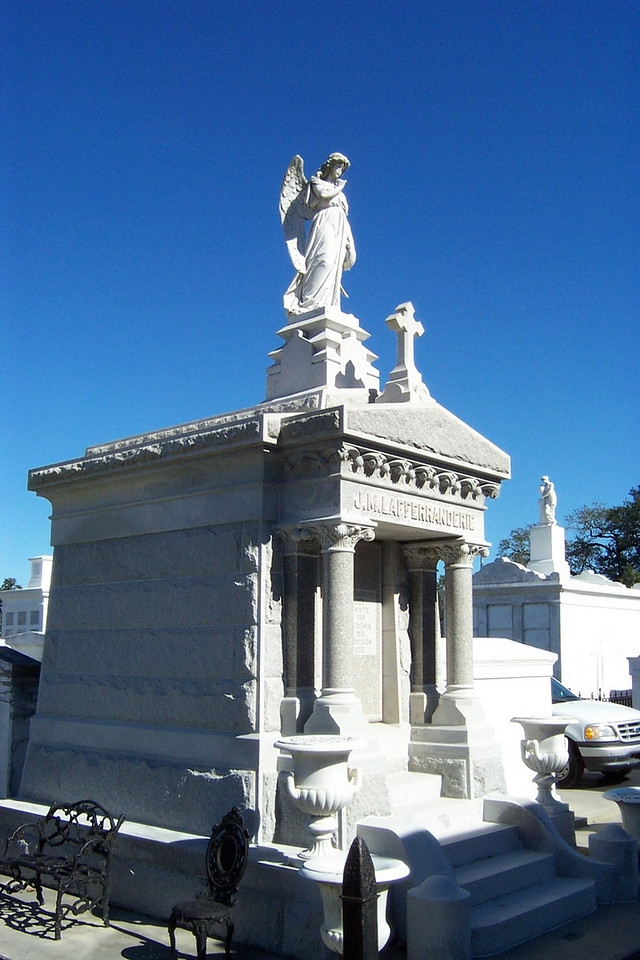Some of the crypts in the cemetery were very elaborate.<br /> [New Orleans]
