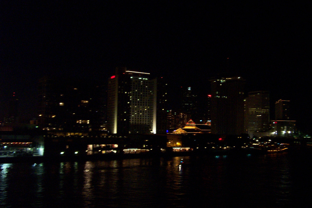 It was dark by the time our cruise ship left the dock, so we had this lovely nighttime view of the city as we sailed down the river.<br /> [New Orleans]