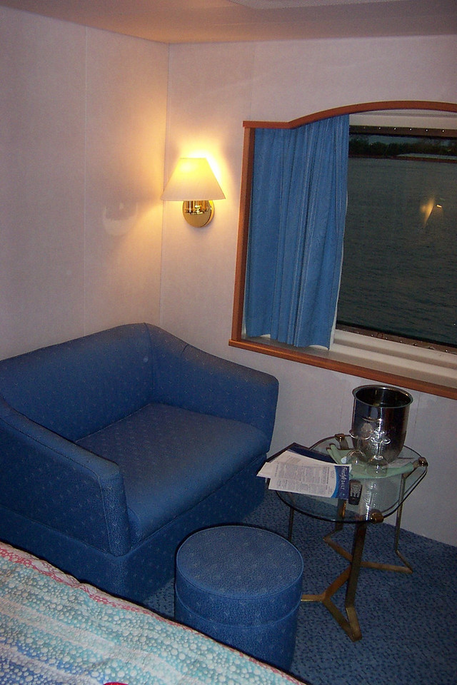 Opposite the television, the cabin's sitting area also included a love seat.<br /> [Aboard the Norwegian Dream cruise ship]