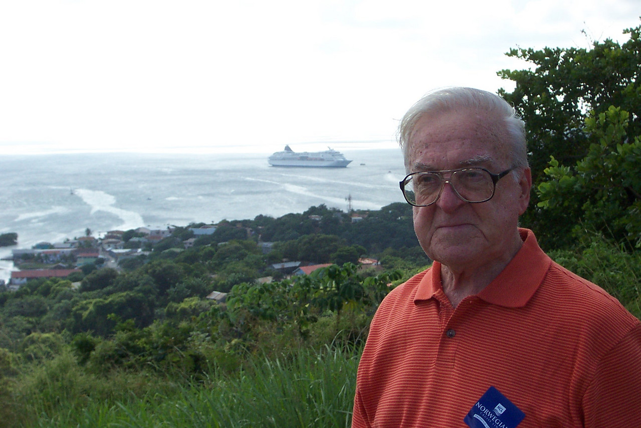 """Dad overlooks the town of Coxen Hole where we came ashore.  In 17th-century seafaring parlance, """"hole"""" was used to designate a bay with good anchorage.  Roatan is a long, skinny island that runs east-west.  The town is on the south side, which faces mainland Honduras (too far away to see).<br /> [Roatan, Honduras]"""