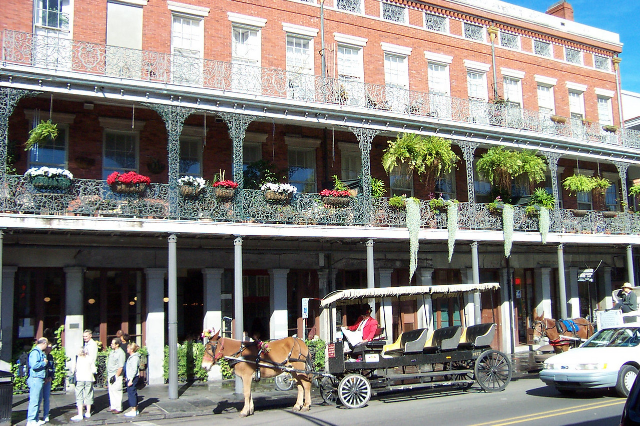 This building with the pretty balcony was right across the street from Cafe du Monde.<br /> [New Orleans]