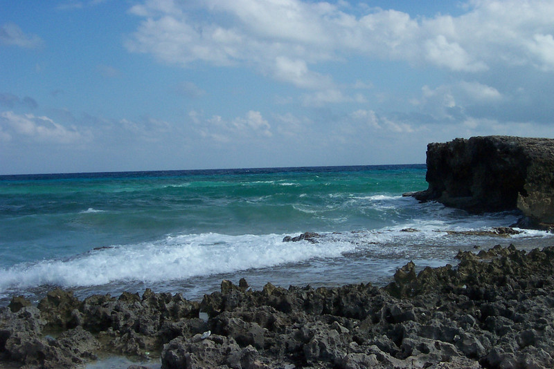 Hurricanes, the pounding surf, and other rough weather make it impossible to maintain a sandy beach on the east side of the island, as all the sand gets driven inland.<br /> [Cozumel, Mexico]