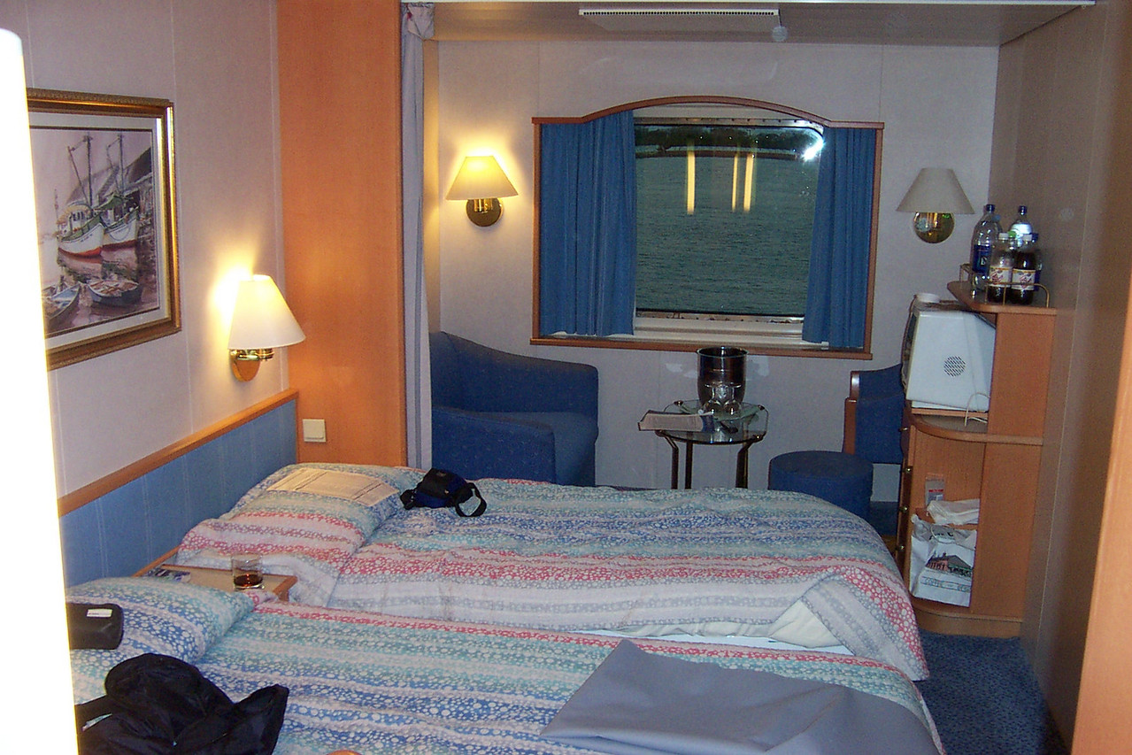 Welcome to cabin 5028.  It was compact, but very comfortable!<br /> [Aboard the Norwegian Dream cruise ship]