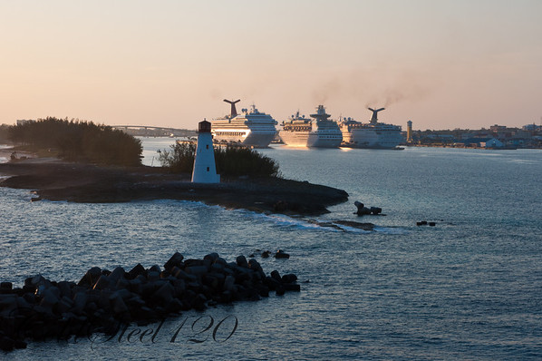 Pulling into port at Nassau with three other ships docked.