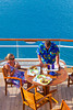 A couple having lunch on an outside deck on the Celebrity cruise ship Millennium.