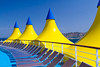 Yellow and blue canopies on the deck of the cruise ship Costa Deliziosa in the Persian Gulf.