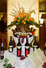 A flower centerpiece and wine bottle display on the Holland America cruise ship Noordam.