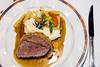 Dinner plate of  Filet of Beef Wellington on the Holland America cruise ship Zaandam