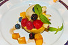A fresh fruit plate attractively presented as a dessert on the Holland America cruise ship Zuiderdam.