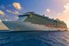The Regal Princess cruise ship at sunset anchored off the Princess Cays, Bahamas.