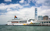 The Kowloon skyline with a Star Cruises cruise ship at the Port of Hong Kong, China, Asia.