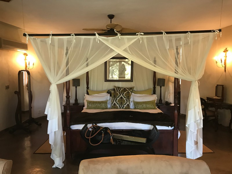 "After our time in Johannesburg, one of our trip's biggest highlights awaited us as we headed to the ""Tintswalo"" Lodge at Krueger National Park to enjoy 6 ""Game Drives"".<br /> <br /> As you'll see from above & the next couple of pictures the rooms at the Lodge are absolutely stunning!<br /> <br /> FYI, of our group of 27 people, 10 flew home after Johannesburg and didn't do a Safari extension like this and from the sounds  of it 10 out of 10 of them regretted it! So, don't make this mistake and think you're going to see everything you want to on the Chobe River, the animals in this region are unique and it was a totally different experience from the Safaris up at Chobe."
