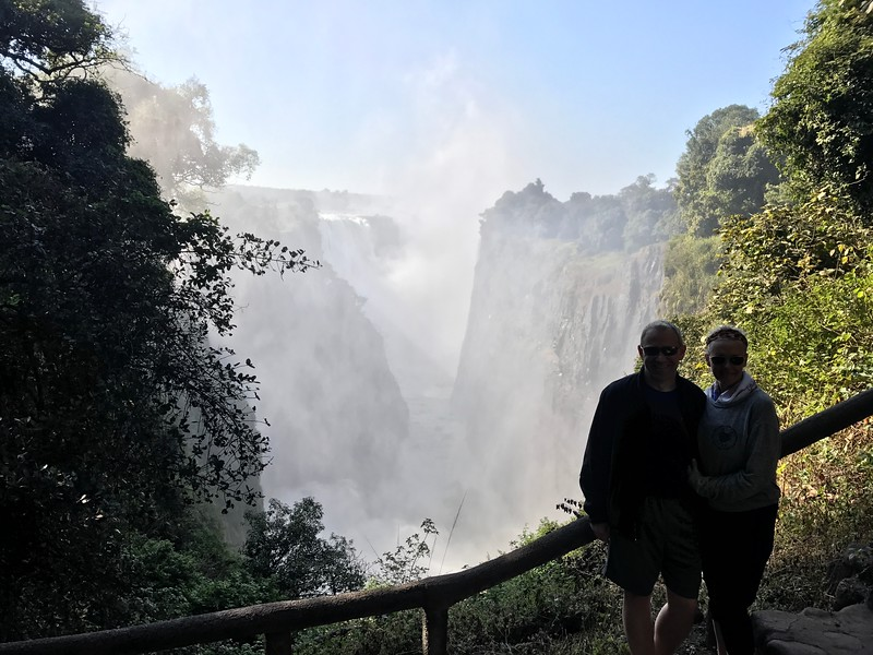 """For our next day in Victoria Falls though we got up close & personal to this mile wide Falls... no wonder it's one of the """"Seven Natural Wonders of the World""""!<br /> <br /> It was a really cool experience as we got to walk right along the falls for quite a bit... and the further we walked, the wetter we got... super fun! :-) It's for sure an experience you'll never forget!"""