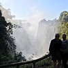 "For our next day in Victoria Falls though we got up close & personal to this mile wide Falls... no wonder it's one of the ""Seven Natural Wonders of the World""!<br /> <br /> It was a really cool experience as we got to walk right along the falls for quite a bit... and the further we walked, the wetter we got... super fun! :-) It's for sure an experience you'll never forget!"