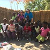 "One other highlight of our time on the ""Zambezi Queen"" in the Chobe River area was our visit to a small village in Namibia. It was something else seeing how locals live in this part of the World (their mud houses are really unique!) and it was a nice feeling to bring school supplies to some of the kids... definitely nice to get in touch with the locals too, amongst all of our wildlife viewing!"