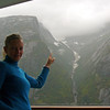 "There's Nancy pointing out one of the many waterfalls we saw from our Private Balcony as we cruised through ""Tracy Arm."""
