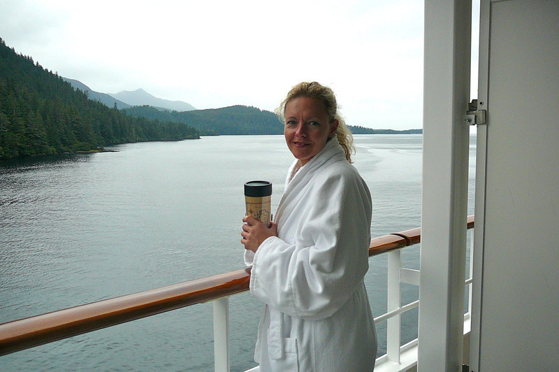 There's Nancy looking all comfy in her Robe while enjoying a Coffee as we Cruise around Silver Bay. :-)