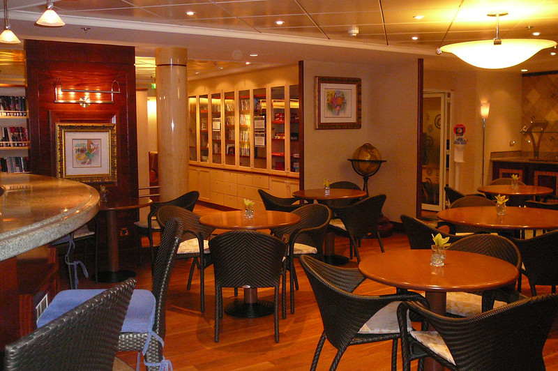 """One of the nicest places to relax on the Mariner is the """"Coffee Connection"""" area. A great place to socialize over a warm """"cup of Joe"""" or to enjoy a good book out of the next door Library!"""