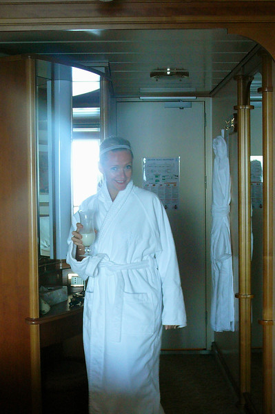 "There's Nancy getting prepared to head out to our Private Balcony to enjoy our ""sail away"" out of Victoria... a comfy Robe, a ""Pina Colada"", what else could you want! :-)"