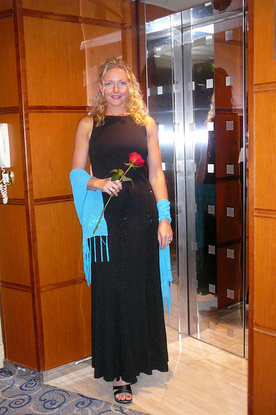 """There's Nancy, rose in hand, heading back to our Suite after a great meal at """"Signatures""""... it seems as if a great Meal brings out the Beauty in a Lady!! :-)"""