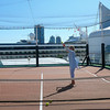 """At the back of the """"Mariner"""" they have a great Paddle Tennis court. There's Nancy getting a little exercise on this Beautiful Vancouver day!!"""
