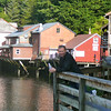 "There's Shawn enjoying the Historic ""Creek Street"" area. Check out the cute small houses built on stilts that go throughout the Creek... most have been turned into trendy little Alaskan shops."