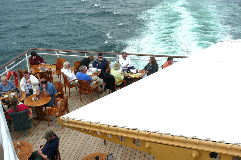 "There's a shot of one of the nicest places on the Ship to enjoy a casual meal... at the back of the ""Oceanview Grill"" while the Sea is gently flowing behind you! :-)"