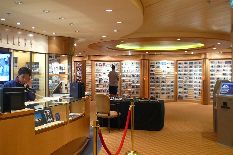 One of our favorite areas on Ships... the Photo Gallery. Throughout the Cruise you can have your photos taken in different settings, on different nights, etc. (without any sitting fees) and you simply buy which ones you like throughout the week... as you can imagine, with all of our Cruises we've done, a nice few of the pictures on our site that you see come through this method. :-)