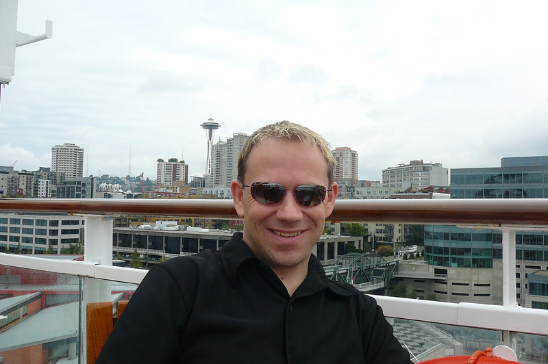 "There's Shawn getting settled in to have a little lunch on the ""Infinity"" before we set sail from Seattle... as you can see from the ""Space Needle"" behind him, Seattle definitely is where we are. :-)"
