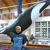"There's Nancy taking a short pause to pose by ""Willy the Whale"" in Ketchikan... alright, we made the ""Willy"" part up... but it is catchy though!! :-)"
