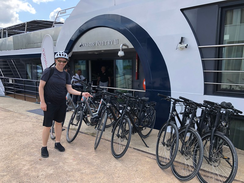 "As we mentioned at the top of this Gallery this ""Active & Discovery"" sailing had a focus on more Active tours like bike rides... even when not on a bike tour though, you could use one of Avalon's bikes that they stored on the ship (they have a couple of dozen of them) to go take a ""spin"" around town. (When they do Bike tours the 3rd party company who offers the tour provides the bikes so there's enough for everyone who wants to join them!)<br /> <br /> There's Shawn grabbing a bike within the first 30 mins of boarding the ship... we figured why not get out & check out Lyon right away!! :-)"