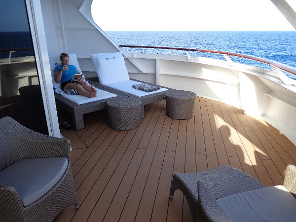 "After using all that energy to ""Take you on a Tour"" of the Azamara Quest - looks like Nancy was ready to enjoy a book & a beverage back on our deck... it's not easy taking all these Cruises for you to help you see what Cruise is best for your next adventure! ... But hey, someones gotta do it! Wink. ;-)"
