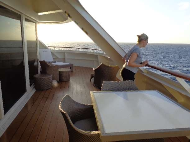 After our tummies were full it was time to enjoy another great sunset at Sea... there's Nancy checking it all out... FYI, if you've never stayed at the back of the Ship and watched the wake of the Ocean before it's a great place to stay!