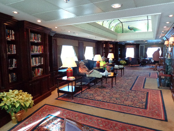 "If the above looks familiar it's because it's where we enjoyed our Private Captain's Dinner we showed you earlier... this is the normal look of the ""Drawing Room"" Library though where you can read a book in absolute peace & quiet... perfect for those book lovers out there!"