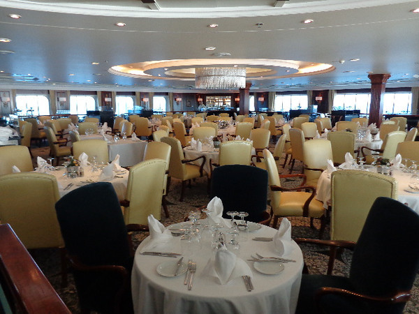 "There's a look at a very yummy place, the Main Dining room called ""Discoveries""... you can enjoy course by course daily Breakfast & Dinner here as well as lunch on Sea days."