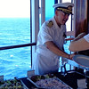 "There's Captain Jose serving up some goodies at the ""Senior Officers Deck Buffet""... that was fun having all the ""Big-Wigs"" serve us! :-) We have to say, of our 36 Cruises Captain Jose was our best Captain yet... it was only his 2nd Cruise with Azamara but he fits in wonderfully with the Family atmosphere they've created... we truly hope you get to sail with him as he's a fun guy with an amazing personality! :-)"
