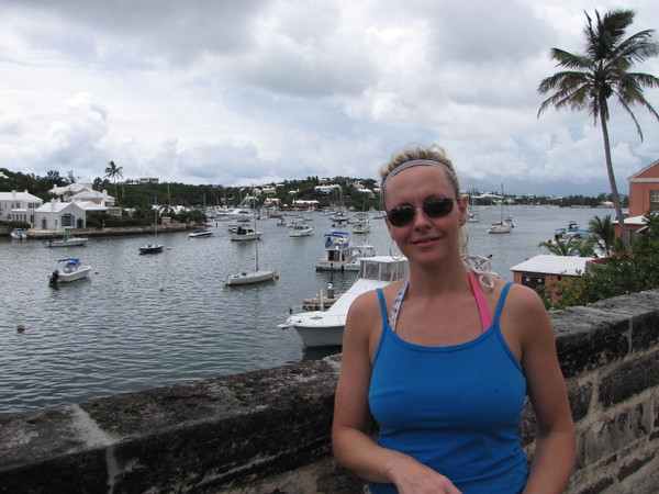 "On Day 2 in Bermuda we decided to check out the Island and head to ""Hamilton"" & ""St. George's""... there's Nancy in Hamilton (in the centre of the Island) enjoying the Warm weather & scenery... seems like everyone has their own boat!! :-)"