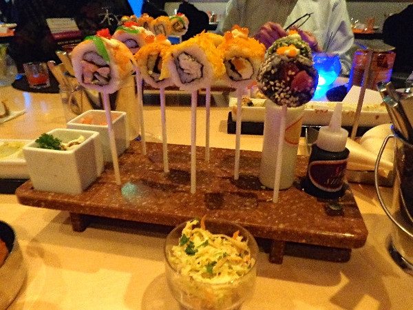"""Sushi Lollipops"" are just one of the many unique food presentations that you'll experience when dining at ""Qsine""... FUN! :-) <br /> <br /> FYI, plan to budget for all the specialty restaurants if you can. (this was $45 per person, Murano $45, Tuscan Grille $35 and Lawn Club Grill $40) The food in the main dining room is nice & not bad for a night or 2 but these places r to die for & not to be missed! You can buy dining packages to keep the cost down which gives you a nice little savings!"
