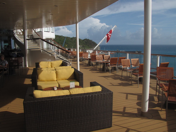 "There's a glimpse at the Beautiful views you'll experience while dining/having a beverage at the ""Ocean view Bar"" at the back of the Ship... just outside the Buffet it's a great place to enjoy Breakfast, Lunch or a Sunset in the evening!!"
