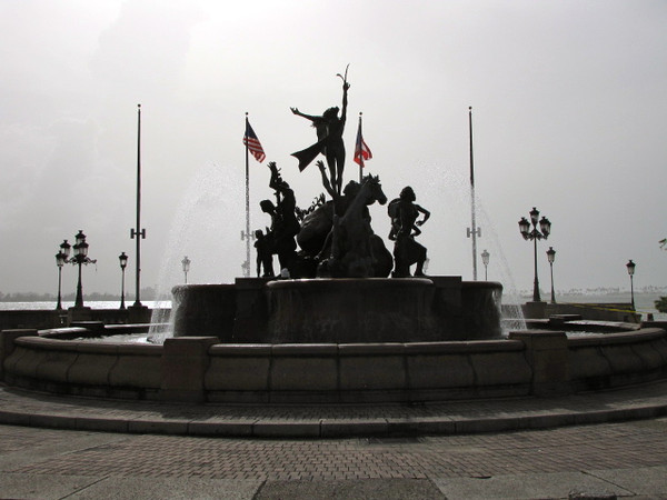 "There's one of the many statues that surround ""Old San Juan"" as you explore this ""Fort"" city."