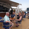 "There's Shawn enjoying lunch at the Pool grill with Mom & Dad... a great place to enjoy an ""open air"" lunch on a Sea Day!"